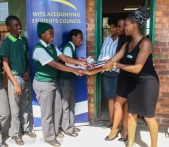 The Wits Accounting Student Council (ASC) handed over calculators and gave a few words of encouragement to disadvantaged learners in Zola, Soweto. Grade 11 accounting students accepting calculators from ASC's chairperson Sewela Makgolane and Social Development office Siphindile Gumede with Miss Magagula.